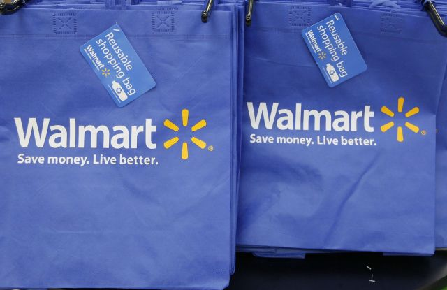 Reusable shopping bags are offered for sale at a Wal-Mart Neighborhood Market, in the Chinatown district of Los Angeles. Wal-Mart is sharpening its attack against Amazon. The discounter says it is changing its membership-based free shipping service test to two days from three days and is charging one dollar less for the annual membership fee. Wal-Mart began testing the service in 2015 as a way to counter Amazon's highly successful Prime shippingWal-Mart-Delivery, Los Angeles, USA