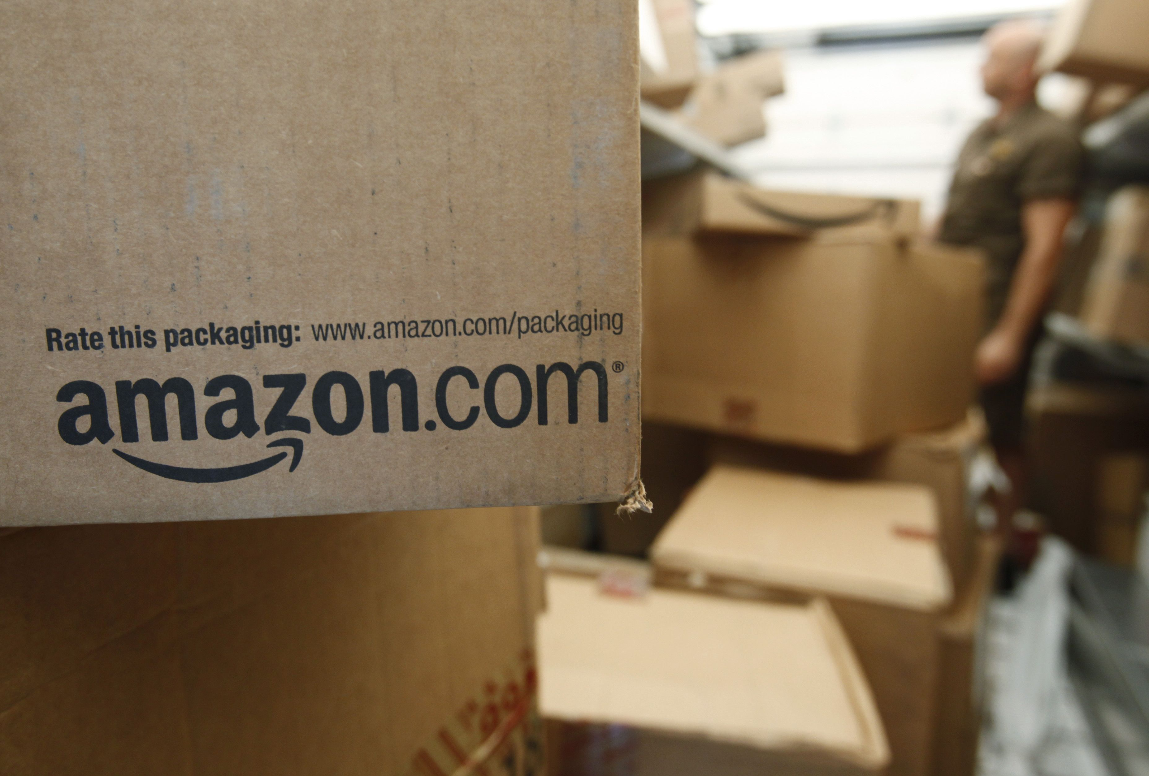 Amazon.com An Amazon.com package sits in a UPS truck in Palo Alto, Calif. As of 2014, the company is the biggest online retailer in the U.S., commanding about 20 percent of all e-commerceSmart Spending Avoiding Amazon, Palo Alto, USA