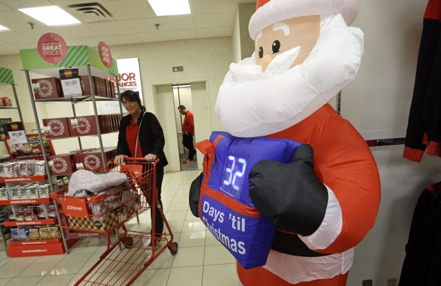 A shopper rolls a full cart past a Santa figure with a countdown clock numbering the days until Christmas at a J.C. Penney store, in Seattle. Black Friday has morphed from a single day when people got up early to score doorbusters into a whole season of deals, so shoppers may feel less need to be outHoliday Shopping Black Friday, Seattle, USA - 24 Nov 2017