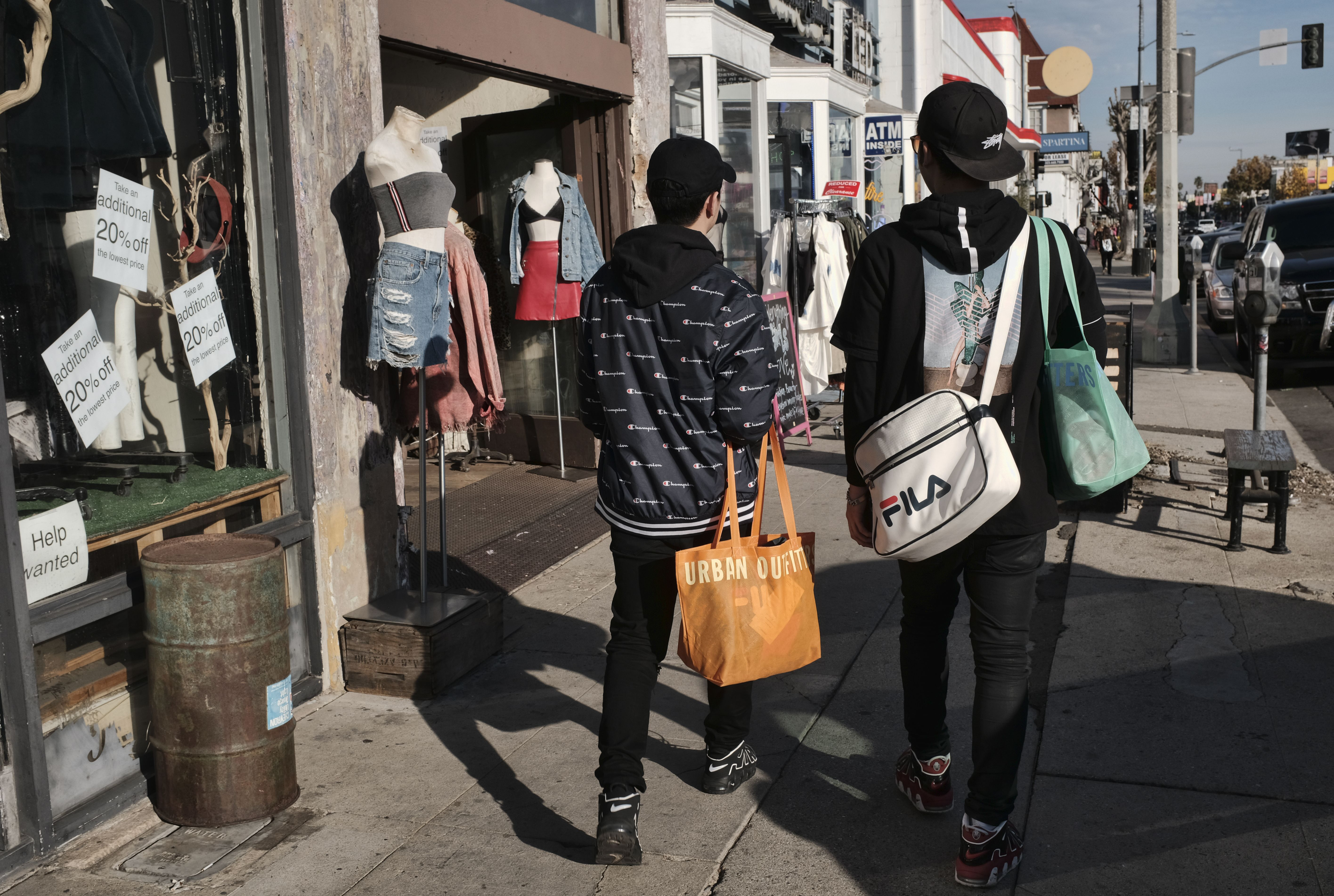 Last minute holiday shoppers walk along a popular clothing district in Los Angeles on . Shoppers who are feeling good about the economy and spending more than expected on items like kitchen gadgets, toys and coats could make this the best holiday season in several years. Shoppers are spending at a pace not seen since the Great Recession, says Craig Johnson, president of retail consulting group Customer Growth PartnersHoliday Shopping, Los Angeles, USA - 24 Dec 2017