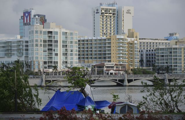 Tents stand on the other side of the shore of Laguna de Condado opposite the exclusive area of ??Paseo Caribe in San Juan, Puerto Rico. Hurricane Maria didn't discriminate between rich and poor when it ravaged Puerto Rico, but the recovery has been another storyHurricane Maria The Rich and The Poor, San Juan, Puerto Rico - 23 Oct 2017