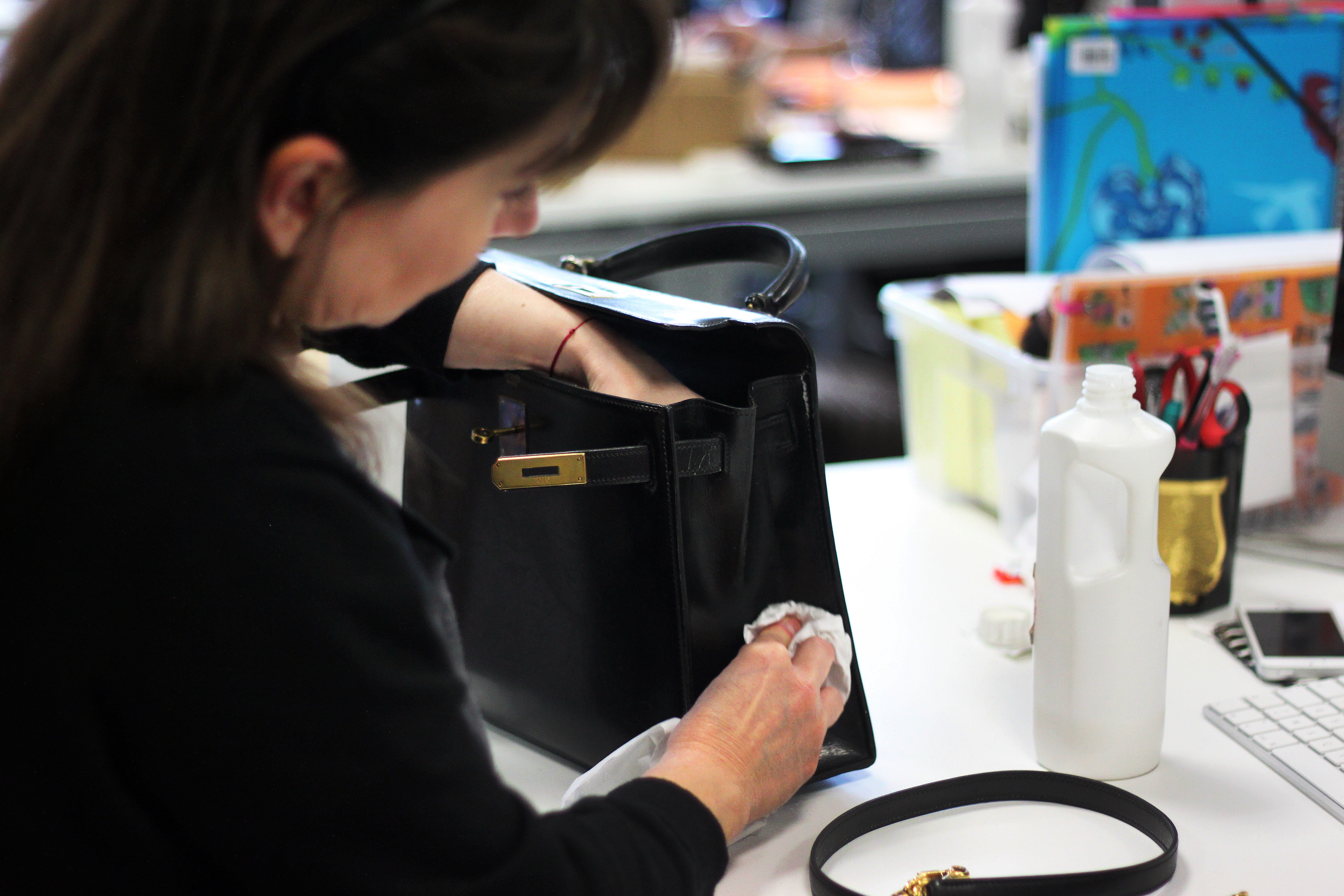 A bag gets reconditioned at Vestiare Collective before being sent to its buyer.