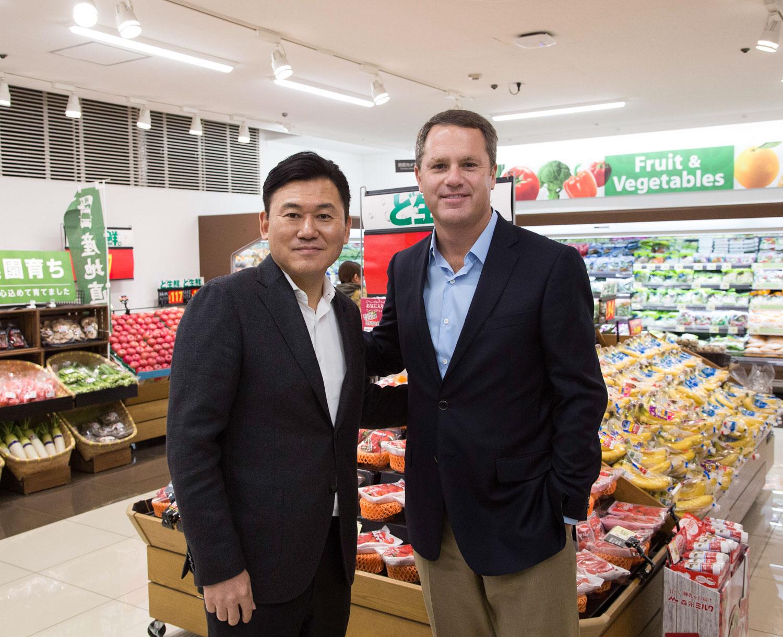 Hiroshi Mikitani and Doug McMillon at a Seiyu store in Japan.
