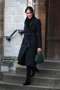 During their Cardiff tour, Prince Harry and  Meghan Markle (in a black Stella McCartney coat and a green DeMellier London bag) watched performances from musicians and poets and met with athletes.