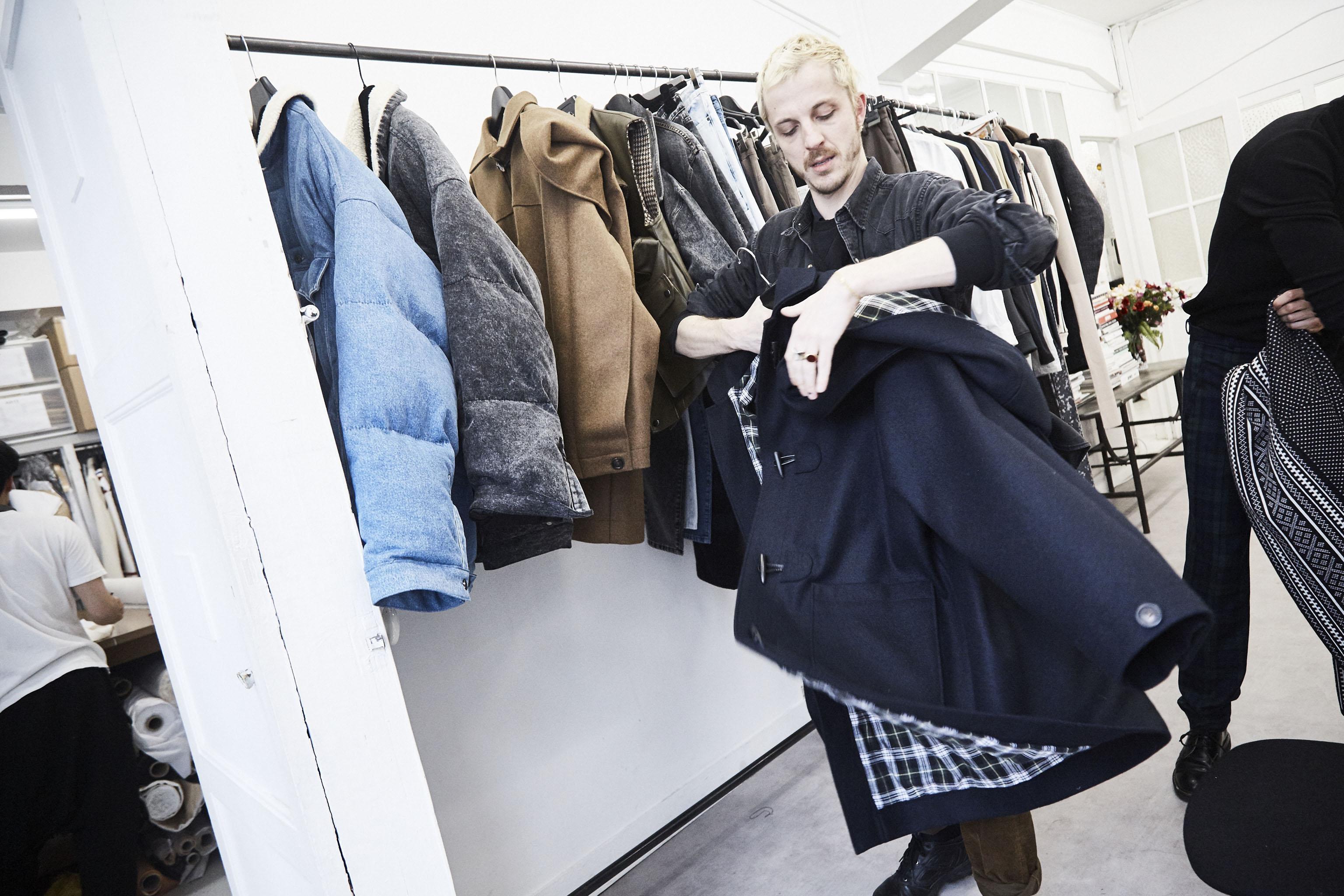 Glenn Martens preps a pea coat at  Y/Project.