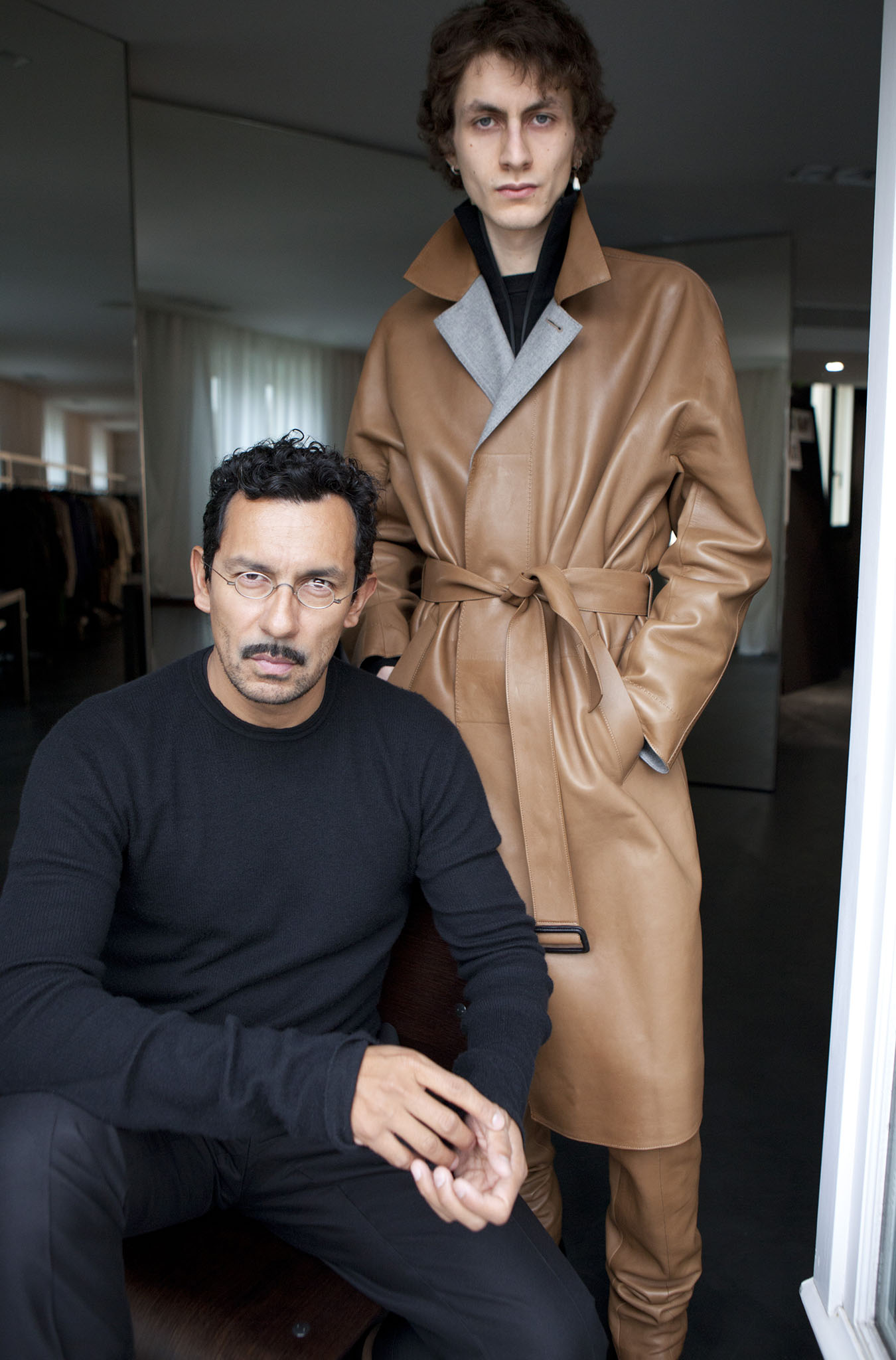 Haider Ackermann and a model in one of his looks for Berluti.
