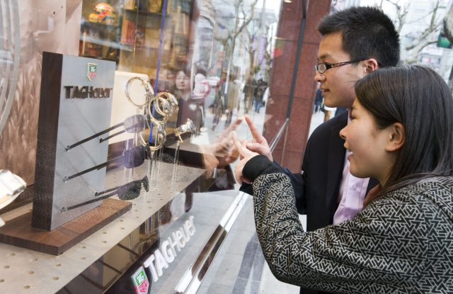 Chinese shoppers peruse a Tagheuer display on Shanghai's Nanjing Road West.