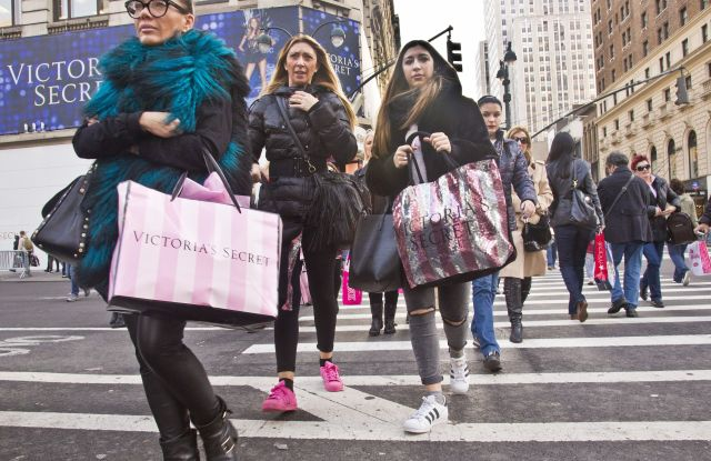 Holiday Shopping Shoppers carry bags as they cross a pedestrian walkway near Victoria Secret in Herald Square, in New York. The early numbers aren't available yet on how many shoppers headed out to stores on Thanksgiving, instead of waiting until today. But it's expected that more than three times the number who shopped yesterday will be out bargain-hunting todayHoliday Shopping, New York, USA