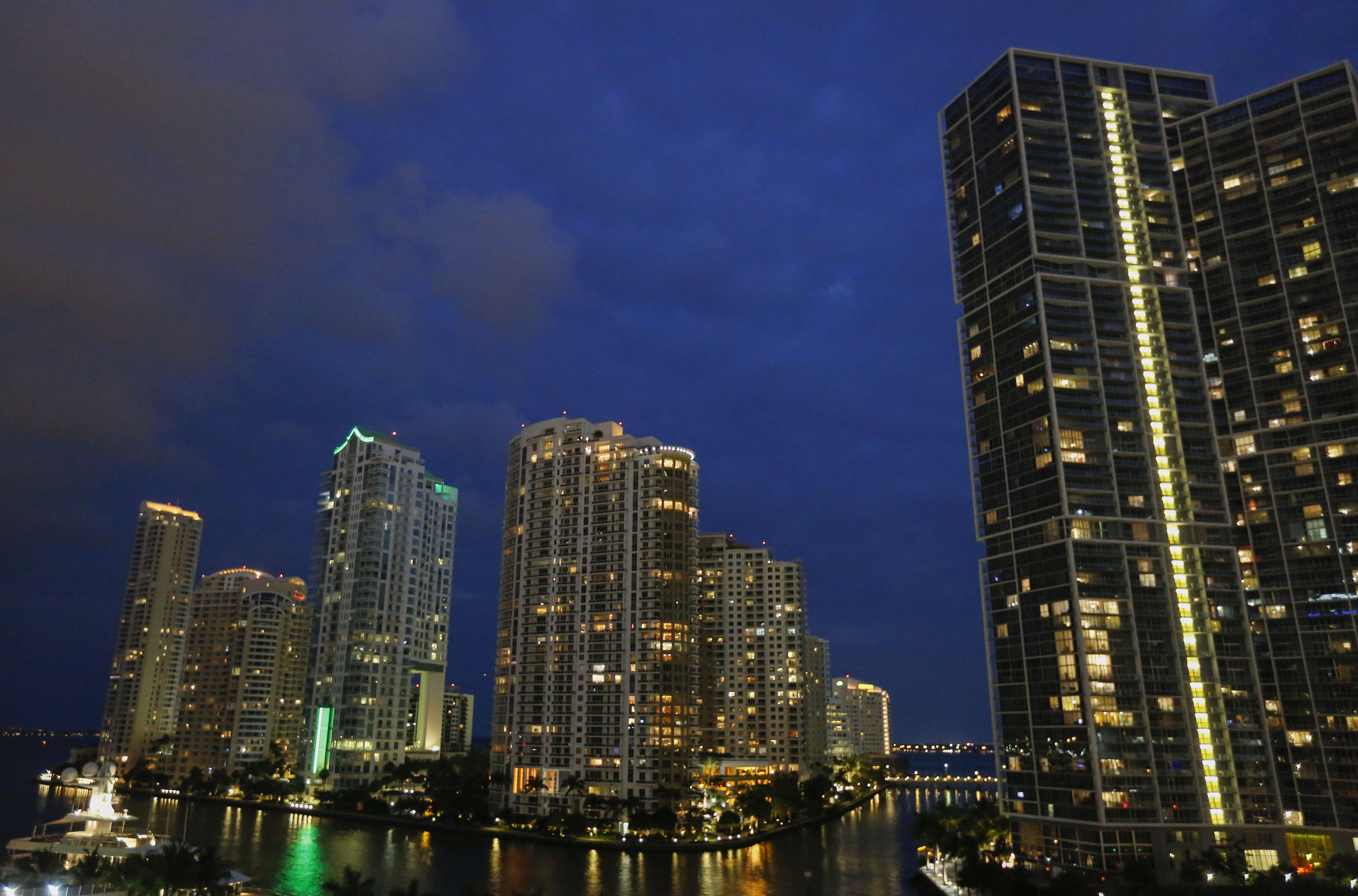 The Brickell Key Skyline is Seen at Dusk in Downtown Miami Florida Usa 23 March 2015 Brickell Key Also Known As Claughton Island is a Man-made Island Created with Developer Henry Flagler Dredged the Mouth of the Miami River in 1896 United States MiamiUsa Miami Weather - Mar 2015