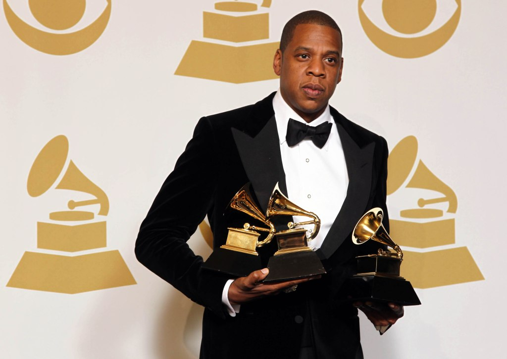 """Jay-Z poses backstage with the awards for best rap/sung collaboration for """"No Church in the Wild"""" and best rap performance for """"N****s in Paris"""" at the 55th annual Grammy Awards, in Los Angeles2013 Grammy Awards Press Room, Los Angeles, USA"""
