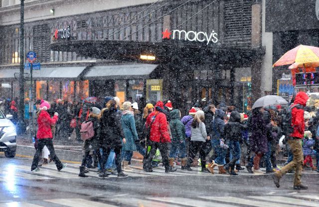 Shoppers brave the snow outside Macy's in hearld Square in New York.Seasonal weather, New York, USA - 09 Dec 2017