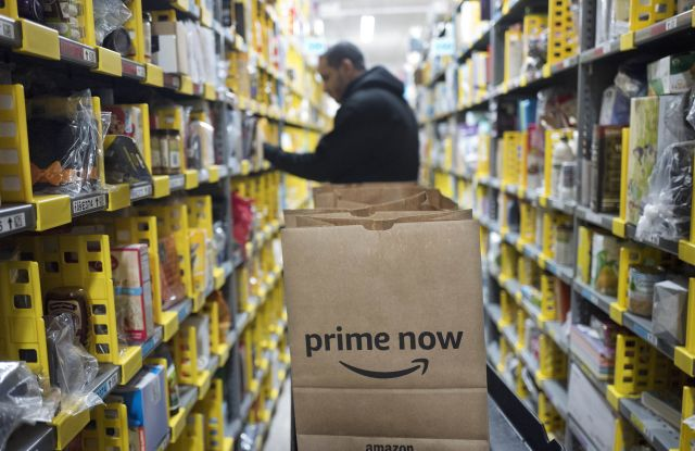 A clerk reaches to a shelf to pick an item for a customer order at the Amazon Prime warehouse, in New YorkHoliday Shopping-Procrastinators Dream, New York, USA - 20 Dec 2017