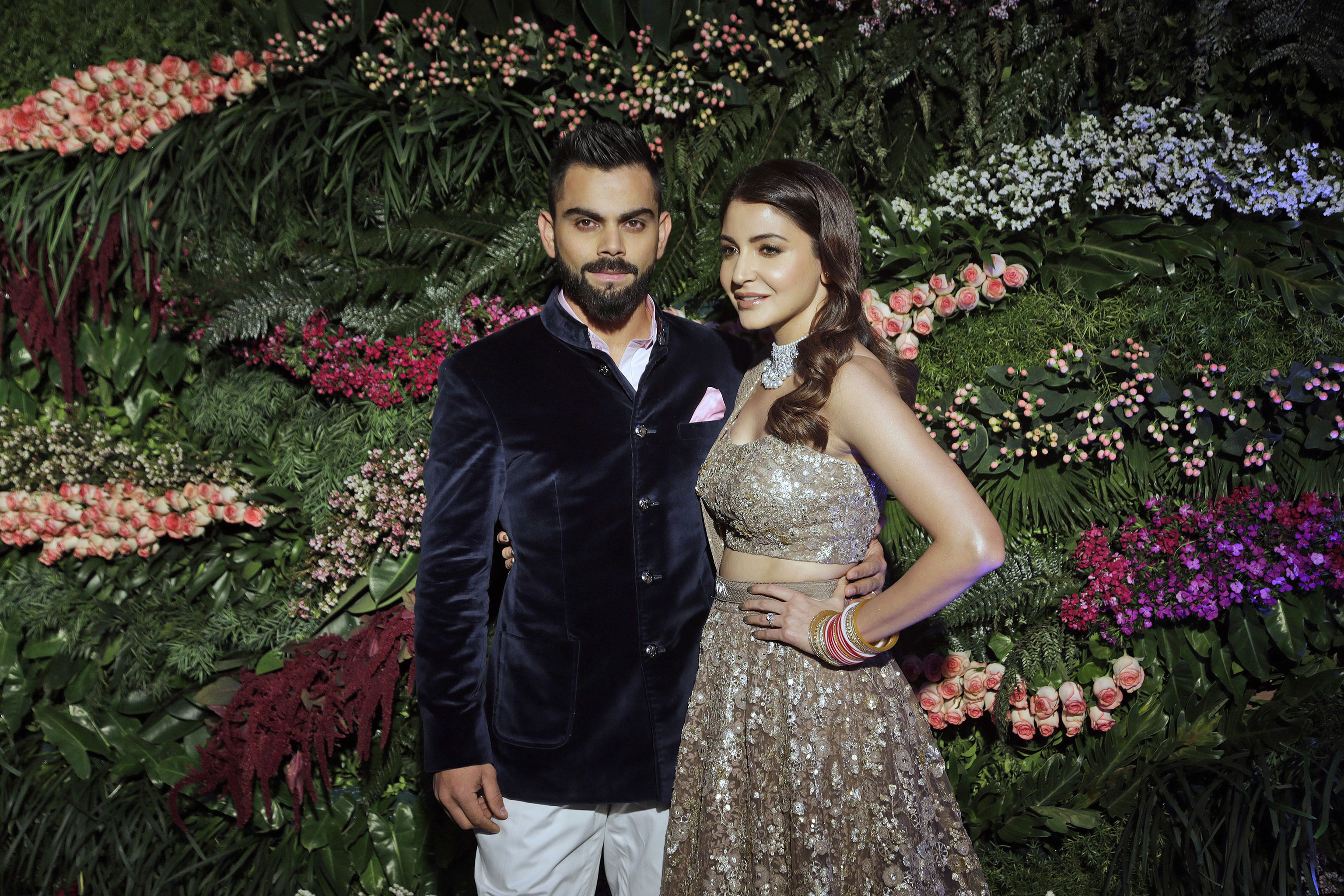 Indian cricketer Virat Kohli, left, and Bollywood actress Anushka Sharma, pose for the photographers during their wedding reception in Mumbai, India, . The couple got married at a heritage resort in the Italian countryside of Tuscany on Dec.11Bollywood, Mumbai, India - 26 Dec 2017