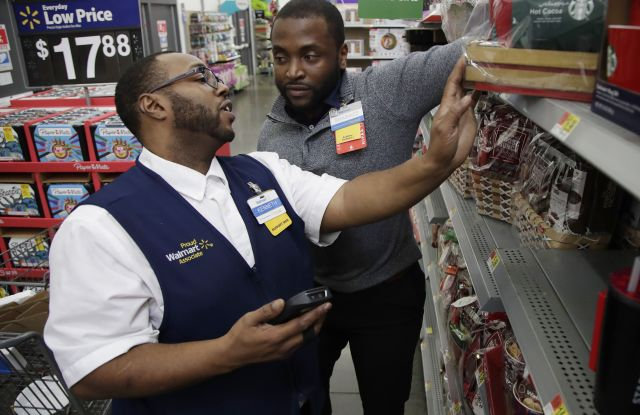Walmart employee Kenneth White, left, is coached by Shabazz Bonner while using an inventory app during a class at the Walmart Academy at the store in North Bergen, N.J. The retail industry is being radically reshaped by technology and nobody feels that disruption more starkly than the 16 million Americans working as shelf stockers, salespeople and cashiersFuture of Work-Changing Retail, North Bergen, USA - 08 Nov 2017
