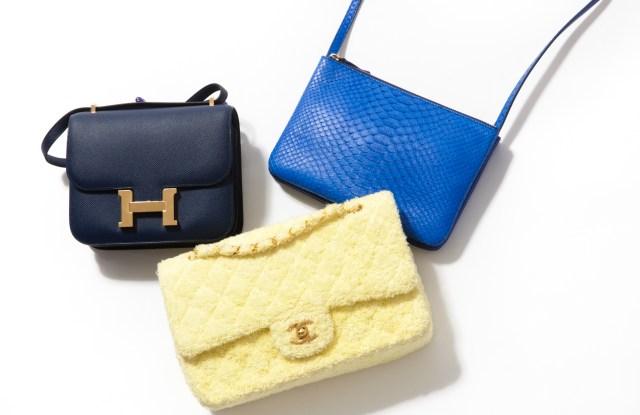Assorted designer handbags.