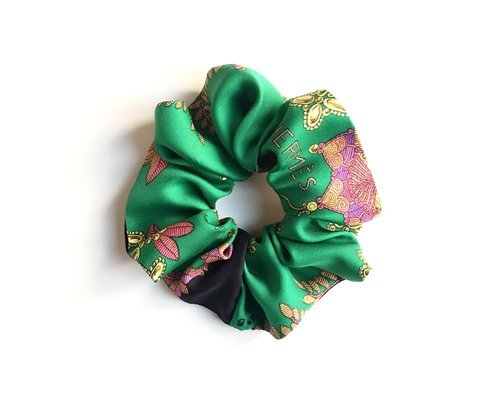 A scrunchie refashioned from a vintage Hermes scarf, designed by Comfort Objects.