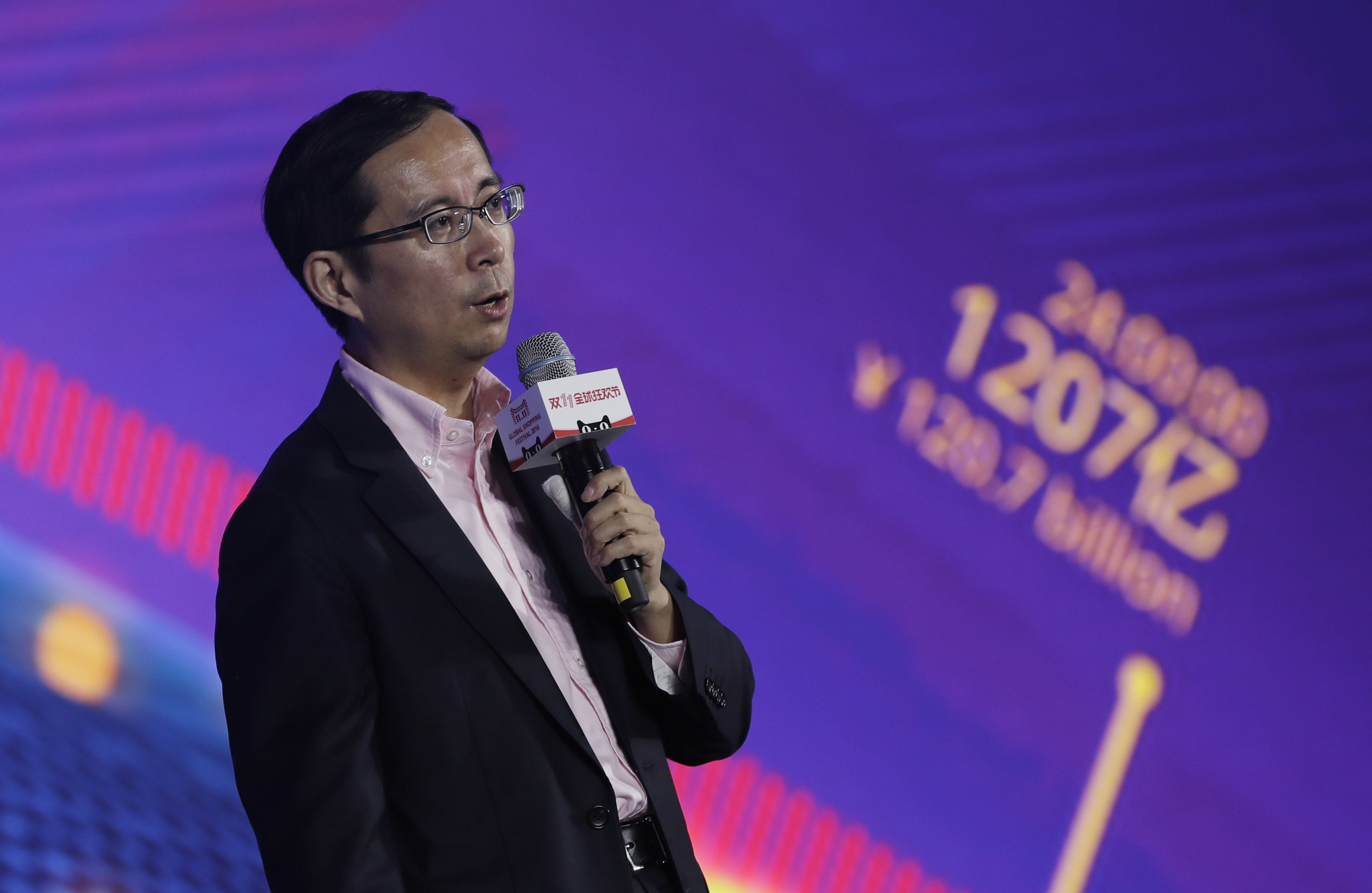 "Daniel Zhan Daniel Zhang, CEO of Alibaba Group speaks on the ""Singles' Day"" global online shopping festival in Shenzhen, southern China's Guangdong province . In a bright spot for China's cooling economy, online shoppers spent billions of dollars Friday on ""Singles' Day,"" a quirky holiday that has grown into the world's busiest day for e-commerceChina Singles' Day, Shenzhen, China - 11 Nov 2016"