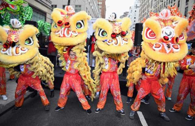 Members of the New York United Lion and Dragon Dance Troupe perform during Madison Street To Madison Avenue: A Lunar New Year Celebration on February 10, 2018 in New York City.