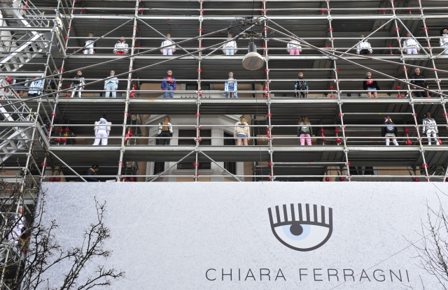 Models pose on scaffolding at the Chiara Ferragni event.