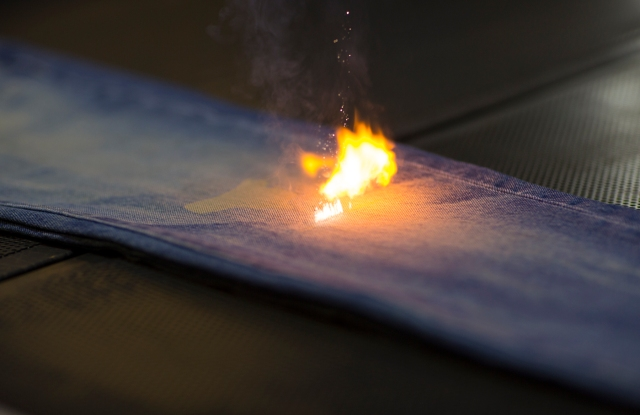 Jeans lasered with flame and destruction