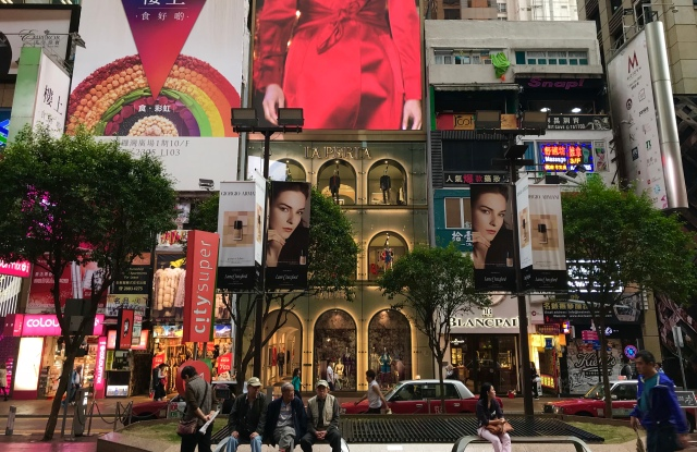 The La Perla store (center) on Russell Street, Causeway Bay. The flagship was built with a large LED screen on top.