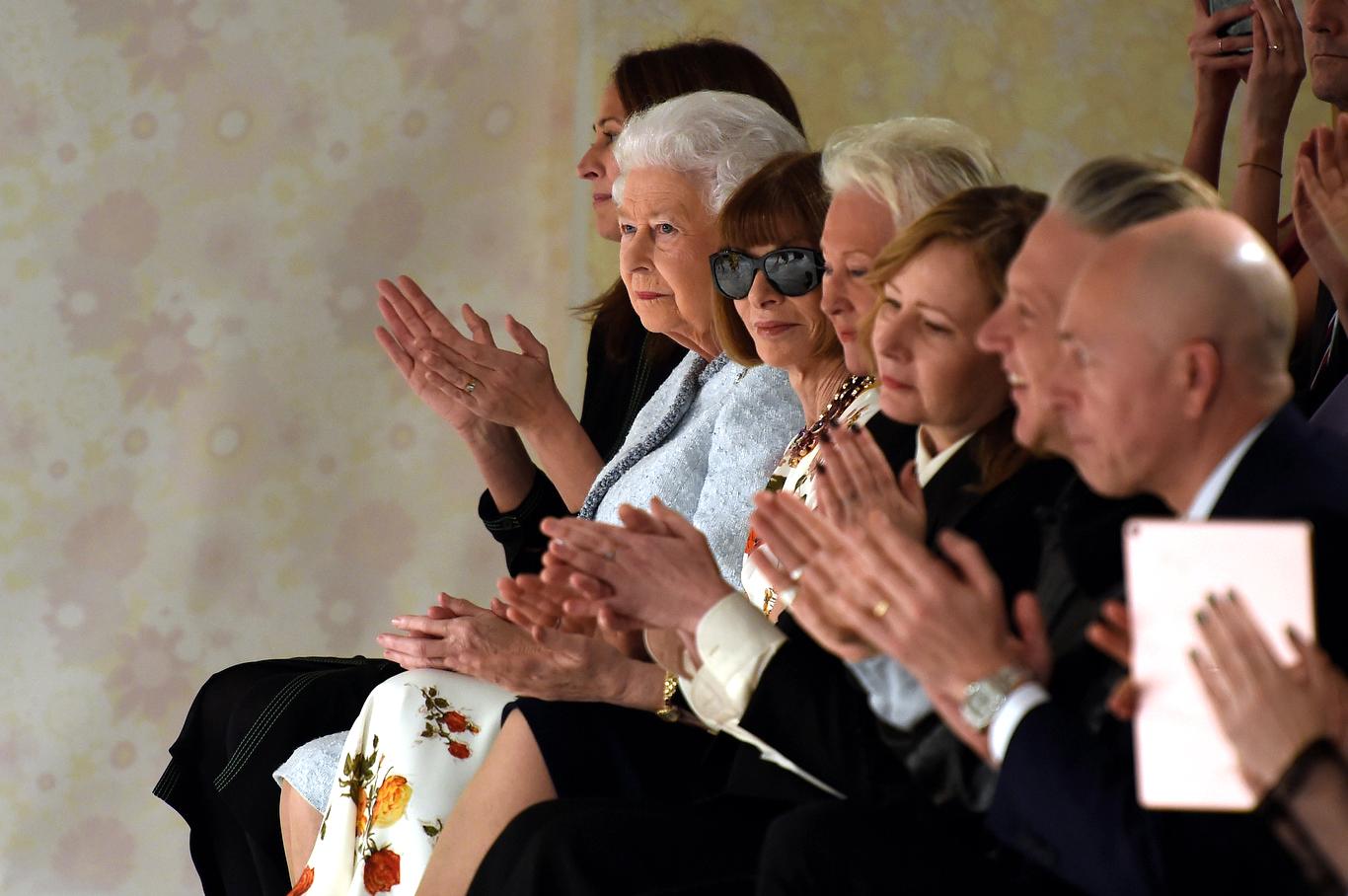 Queen Elizabeth sitting front row between Caroline Rush and Anna Wintour