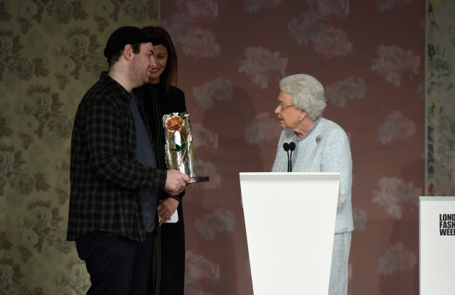 Queen Elizabeth presents Richard Quinn with the award