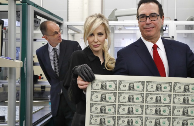 Steven Mnuchin, Louise Linton. Treasury Secretary Steven Mnuchin, right, and his wife Louise Linton, hold up a sheet of new $1 bills, the first currency notes bearing his and U.S. Treasurer Jovita Carranza's signatures, at the Bureau of Engraving and Printing in Washington. The Mnuchin-Carranza notes, which are a new series of 2017, 50-subject $1 notes, will be sent to the Federal Reserve to issue into circulationMnuchin Currency, Washington, USA - 15 Nov 2017