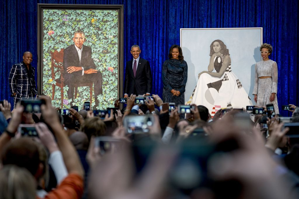 Barack Obama, Michelle Obama, Kehinde Wiley, Amy Sherald. From left, artist Kehinde Wiley, who painted former President Barack Obama's portrait, former President Barack Obama, former first lady Michelle Obama, and artist Amy Sherald, who painted Michelle Obama's portrait, stand on stage together during an unveiling ceremony at the Smithsonian's National Portrait Gallery, in WashingtonObama Portrait, Washington, USA - 12 Feb 2018