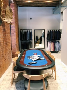 The store has a poker table where customers can relax.