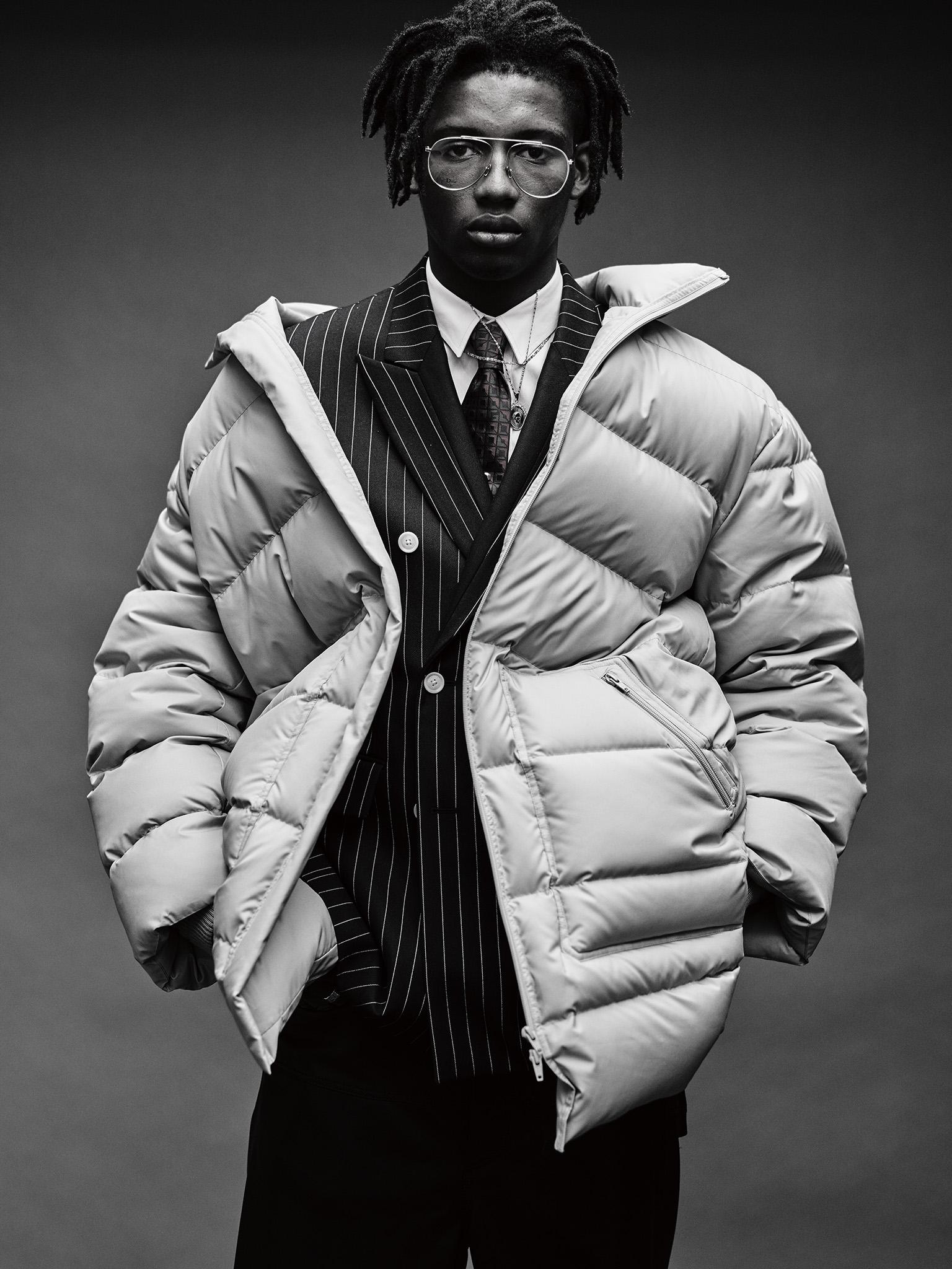 3.1 Phillip LimÕs nylon puffer jacket, VersaceÕs wool blazer, Band of OutsidersÕ cotton shirt and LanvinÕs leather pants. Dior Homme glasses; Gucci tie; Alexander McQueen necklace.