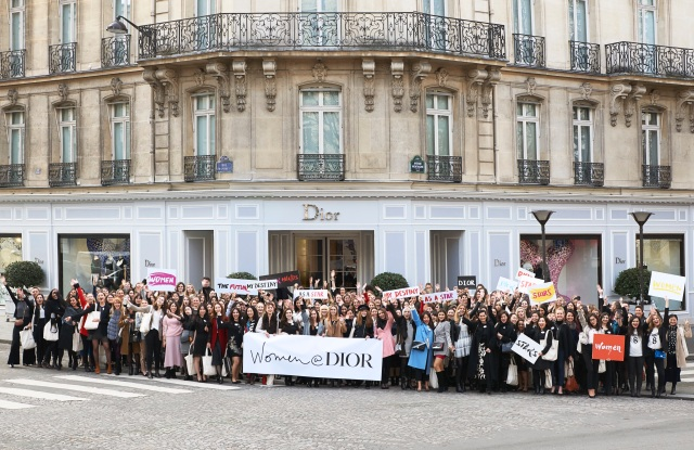 Participants in the Women@Dior event in front of the Dior flagship in Paris.