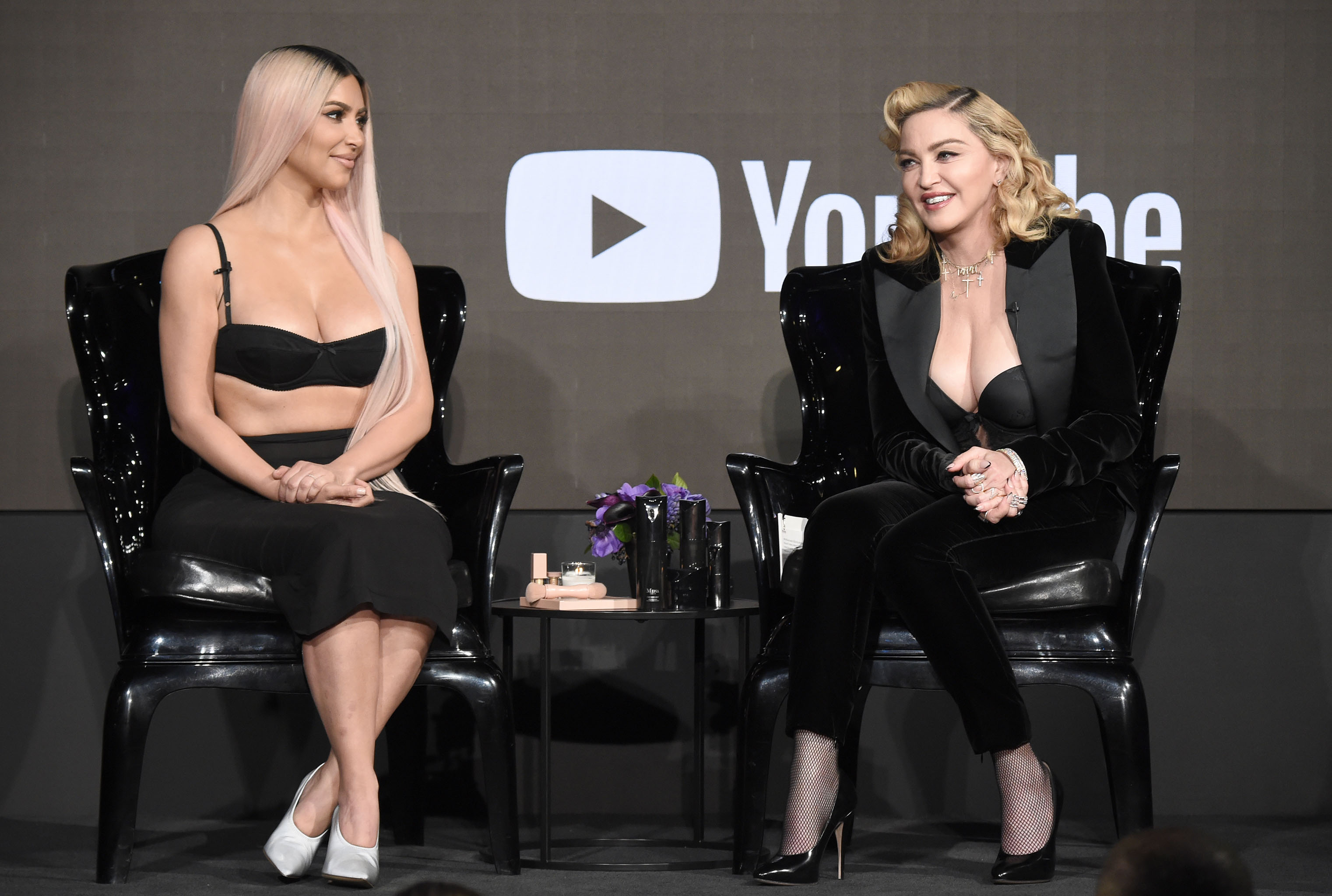 LOS ANGELES, CA - MARCH 06:  Kim Kardashian and Madonna speak onstage at MDNA SKIN hosts Madonna and Kim Kardashian West for a beauty conversation at YouTube Space LA on March 6, 2018 in Los Angeles, California.  (Photo by Kevin Mazur/Getty Images for Madonna's MDNA SKIN) *** Local Caption *** Kim Kardashian;Madonna