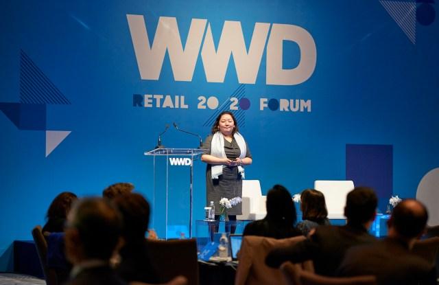 Naomi Yamakawa speaking at WWD's inaugural Tokyo summit in partnership with Lumine.