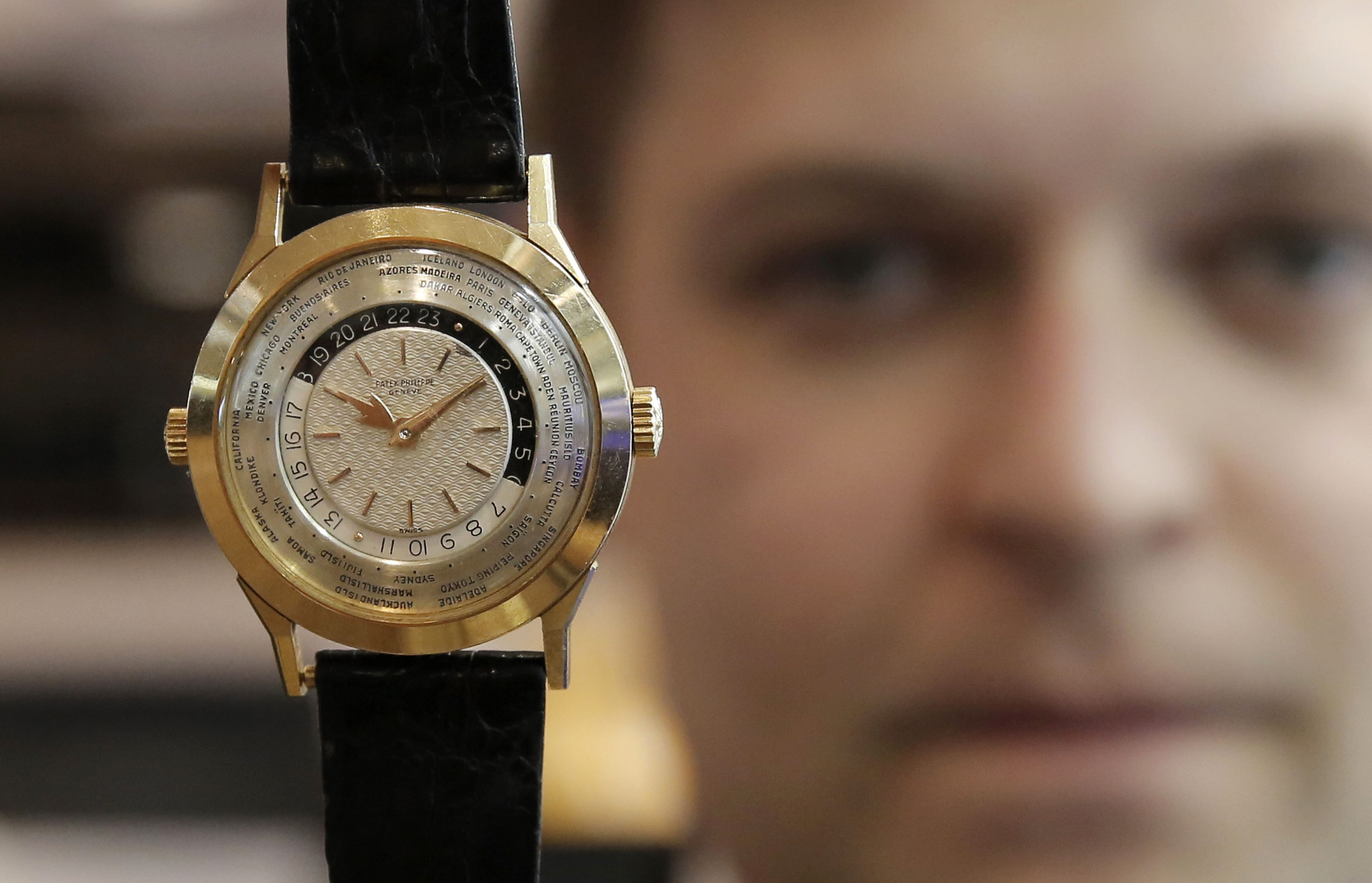 Asia has become a bright spot once again for the watch business. Above, Sam Hines, the global head of watches for Sotheby's holds up a timepiece.