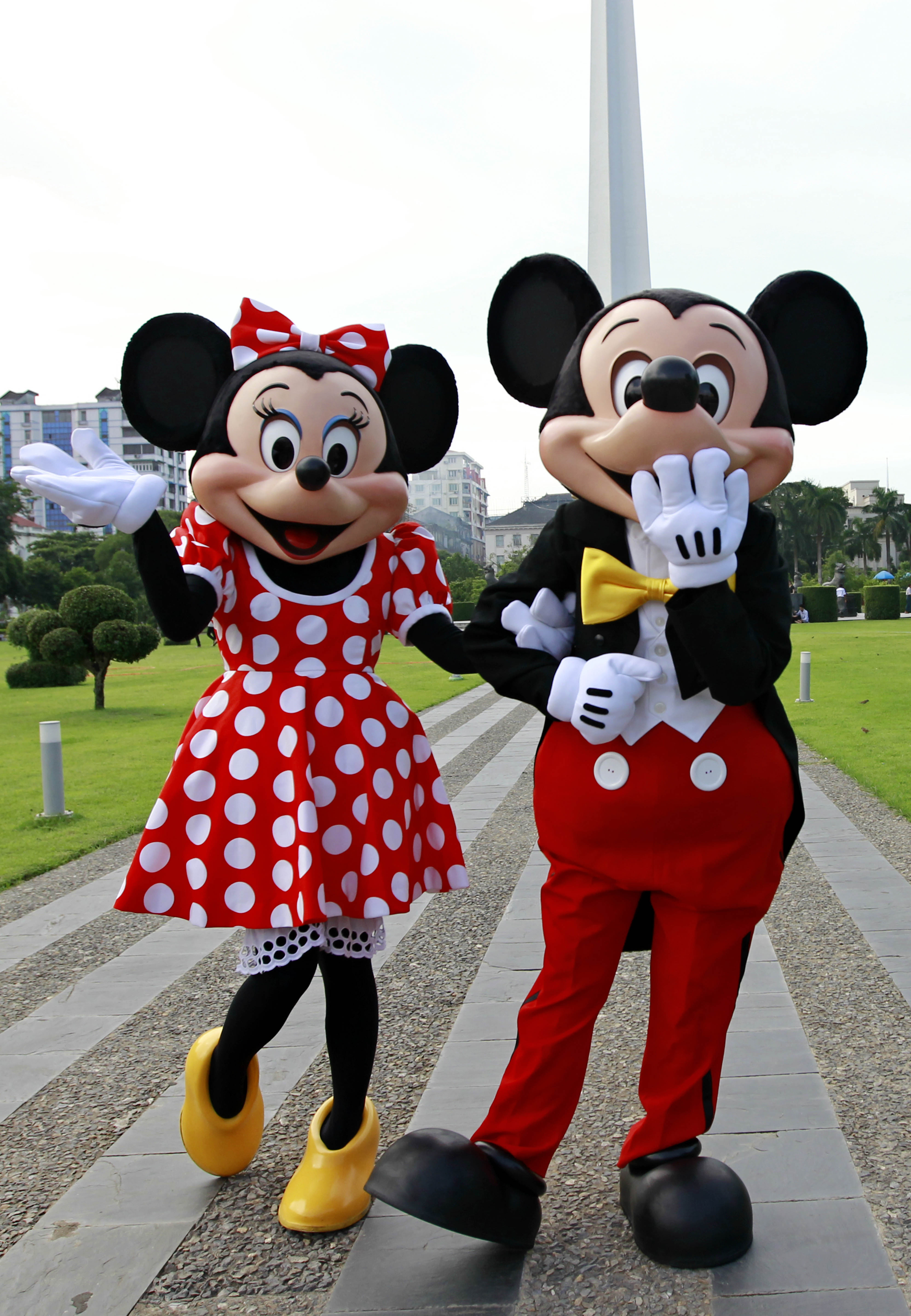 World Famous Disney Characters Mickey Mouse (l) and Minnie Mouse (r) Pose For Photos in Front of the Independence Monument in Yangon Myanmar 25 September 2014 the Walt Disney Characters Are on a Tour in Myanmar to Promote the 'Disney Live!' Presentation of Three Classic Fairy Tales Featuring More Than 25 Disney Characters Such As Snow White and the Seven Dwarfs Cinderella and Beauty and the Beast Planned at the Myanmar Event Park From 08 to 12 October 2014 Myanmar YangonDisney Characters in Myanmar - Sep 2014