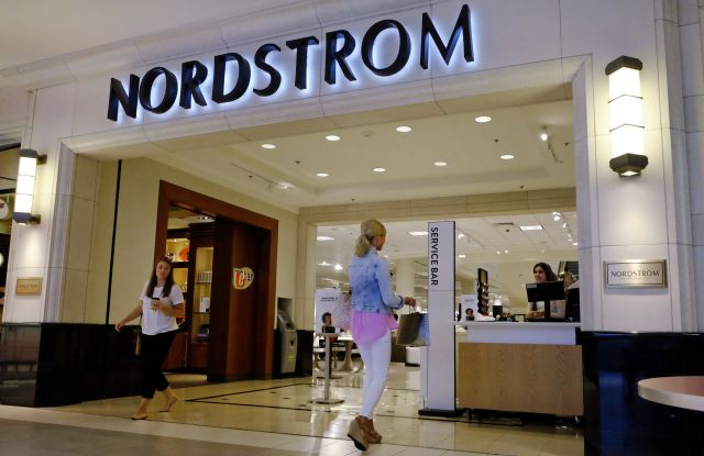 Shoppers leave and enter a Nordstrom store, in Indianapolis.