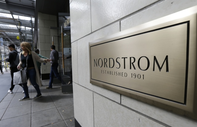 Shoppers come and go from Nordstrom Inc.'s flagship store in downtown Seattle. Nordstrom, Inc. reports earnings Thursday, Nov. 9, 2017Earns Nordstrom, Seattle, USA - 13 Sep 2017