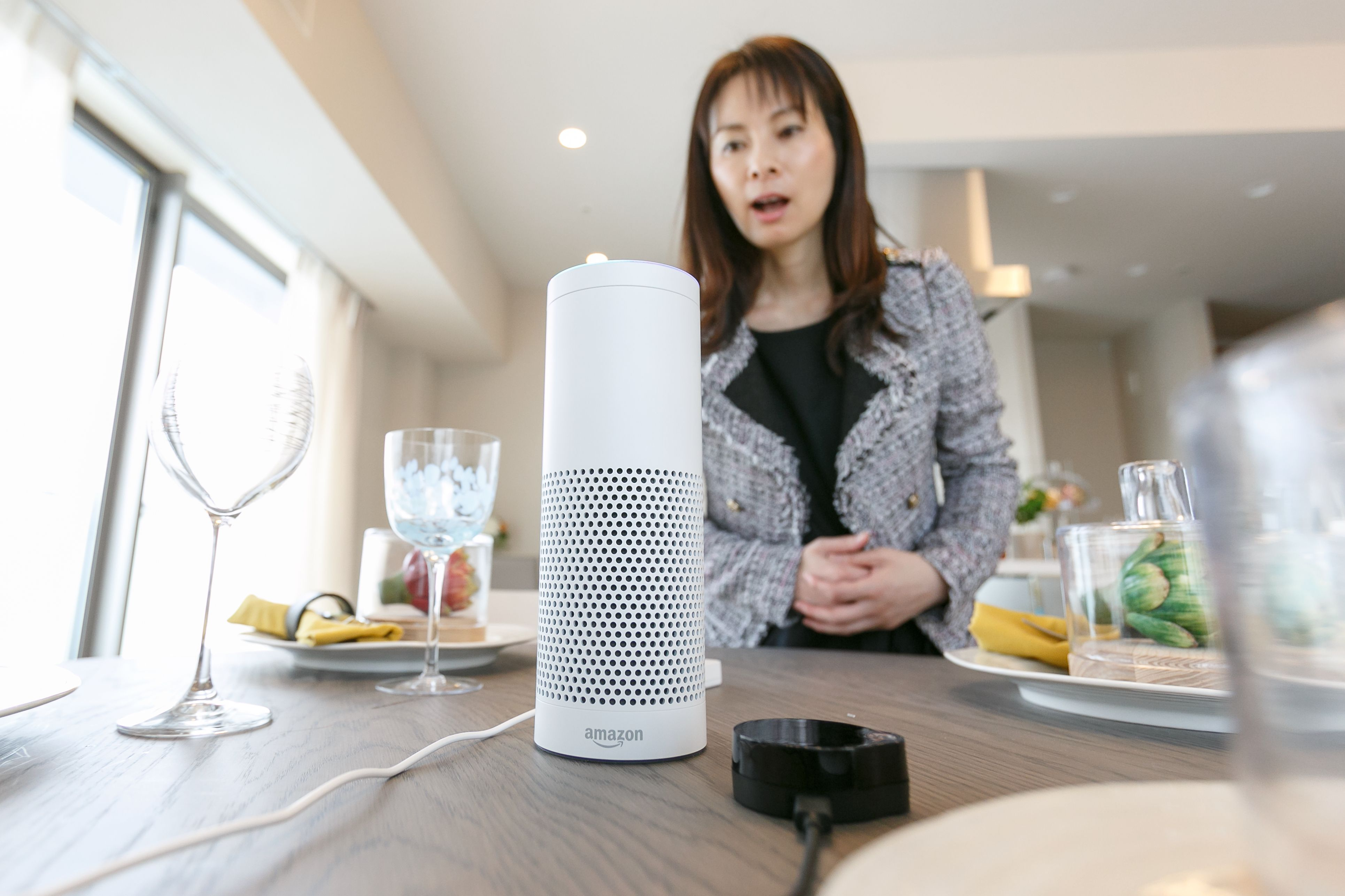 Amazon Echo Plus is a smart speaker programmed with Amazon's artificial intelligence assistant app called Alexa to control home appliances such as TV and lights through human voiceAmazon Echo Plus at MID Base Tower Residence, Yokohama, Japan - 22 Nov 2017