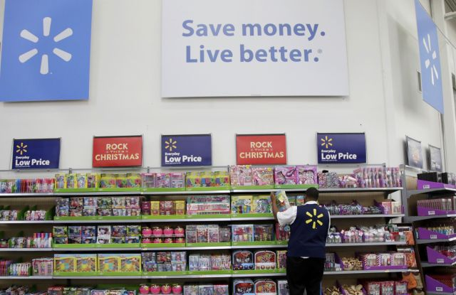 Walmart employee Kenneth White scans items while conducting an exercise during a Walmart Academy class session at the store in North Bergen, N.JFuture of Work-Changing Retail, North Bergen, USA - 08 Nov 2017