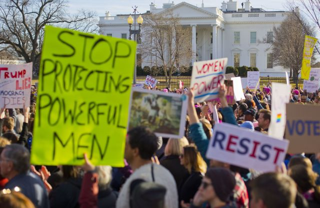 Women's March demonstrators walk past the White House in Washington, . On the anniversary of President Donald Trump's inauguration, people participating in rallies and marches in the U.S. and around the world Saturday denounced his views on immigration, abortion, LGBT rights, women's rights and moreWomens Marches, Washington, USA - 20 Jan 2018