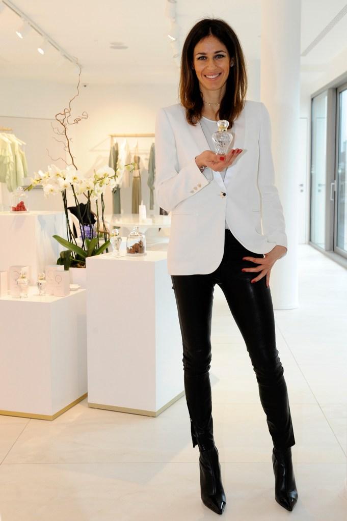 Sara Cavazza Facchini posing with the Genny Platinum fragrance.