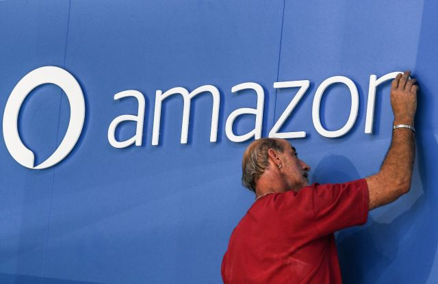 An workers adjust an Amazon Alexa logo at the Internationale Funkaustellung Berlin (IFA), an international consumer electronics fair, ahead of the official opening, in Berlin, Germany, 30 August 2017. The IFA is the world's leading trade show for consumer electronics and home appliances and open for the general public from 01 to 06 September. The fair presents over 1,800 exhibitors from more than 50 countries and expects over 200,000 visitors this year.Last preparations ahead of the official opening of IFA in Berlin, Germany - 30 Aug 2017
