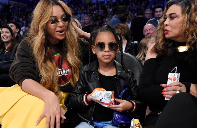 Singer Beyonce, left, sits with her daughter Blue Ivy Carter, center, and her mother Tina Knowles during the second half of an NBA All-Star basketball game, Sunday, Feb. 18, 2018, in Los Angeles. (AP Photo/Chris Pizzello)