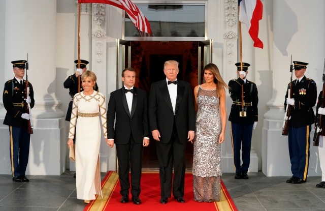 President Donald Trump accompanied by first lady Melania Trump pose for a photo after greeting French President Emmanuel Macron and his wife Brigitte Macron as they arrive for a State Dinner at the White House in Washington, Tuesday, April 24, 2018. (AP Photo/Andrew Harnik)