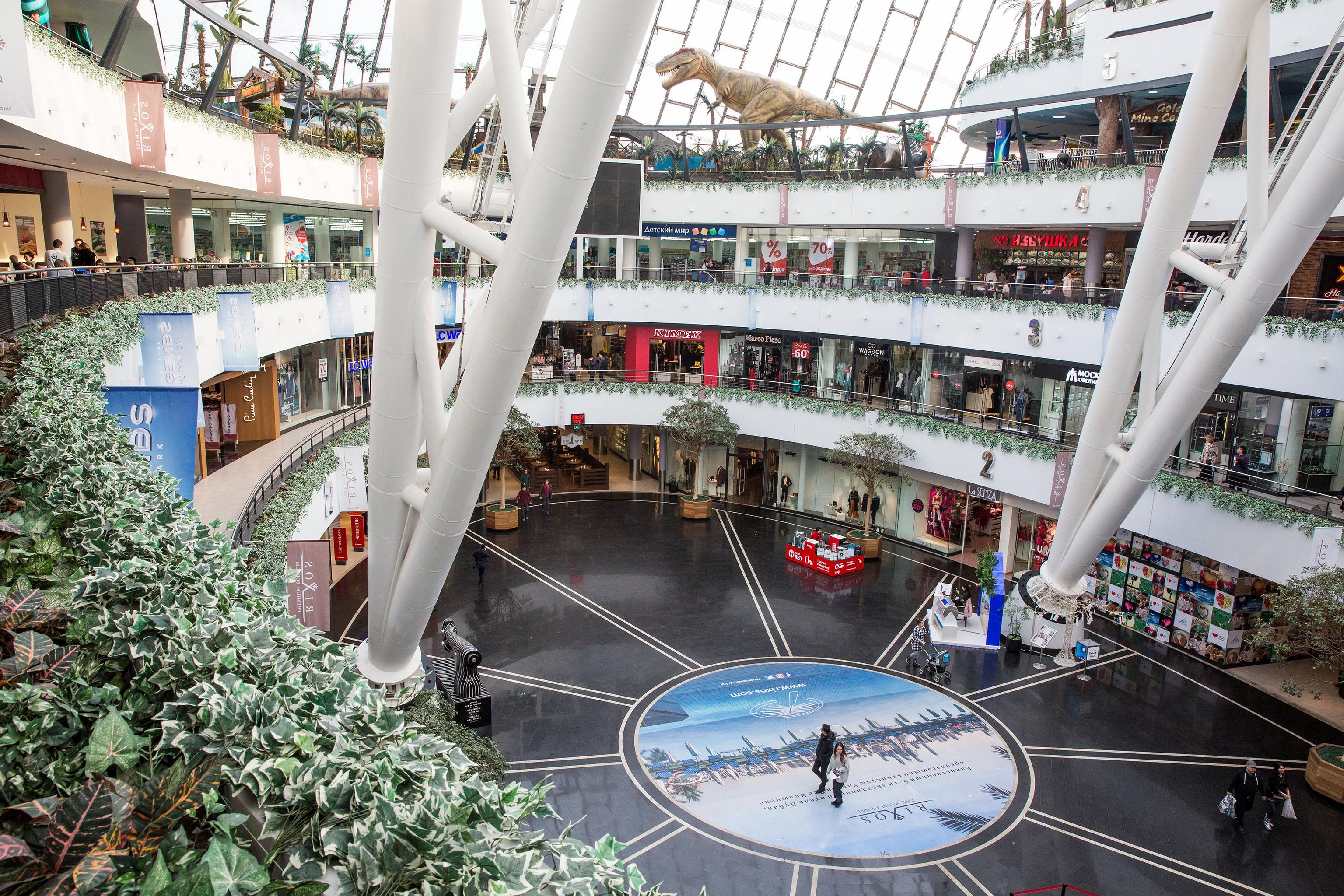 Men and women shop at Khan Shatyr Mall in Astana, Kazakhstan.