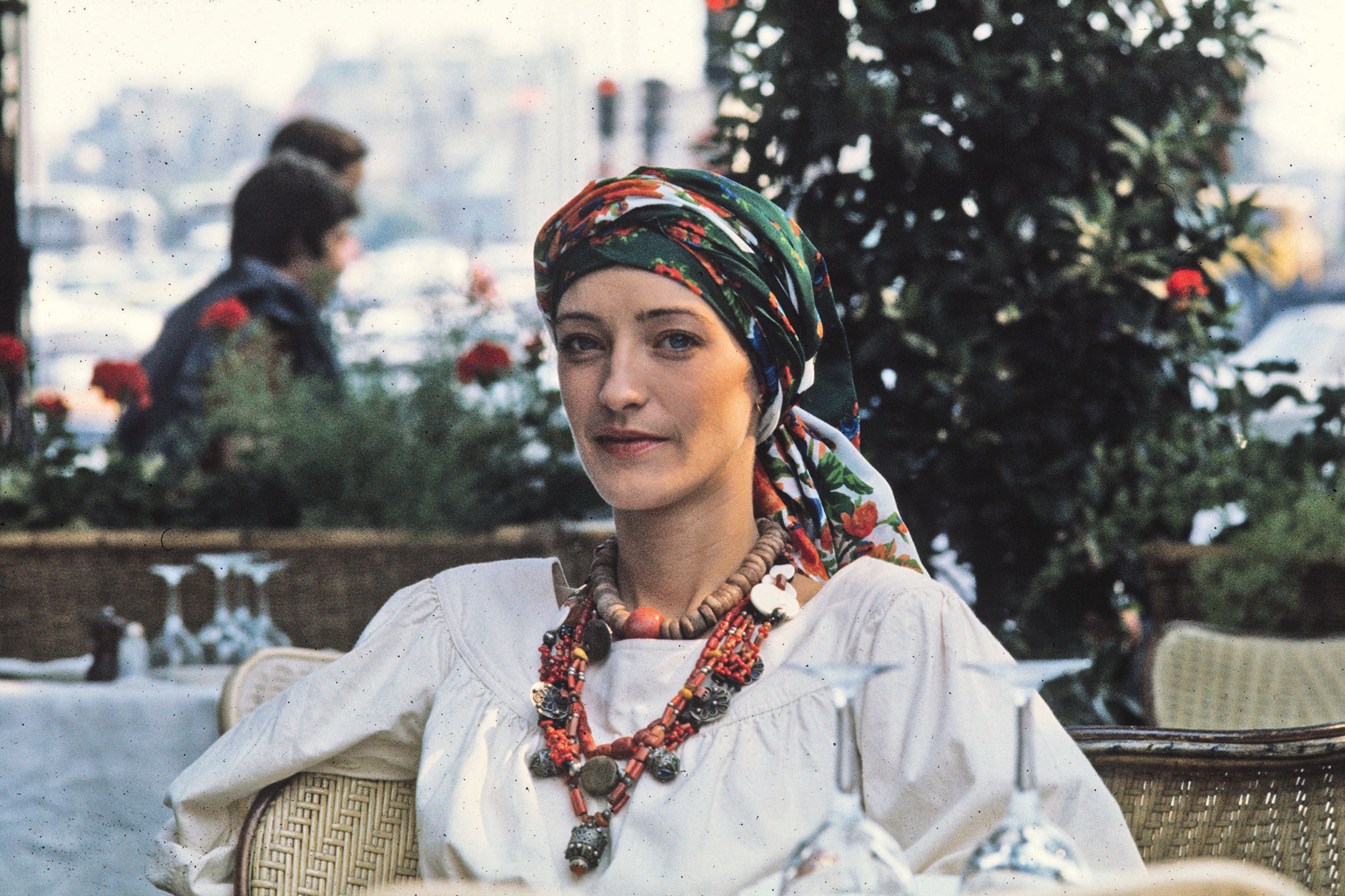 Loulou de la Falaise sitting in an outdoor cafe, 1976.