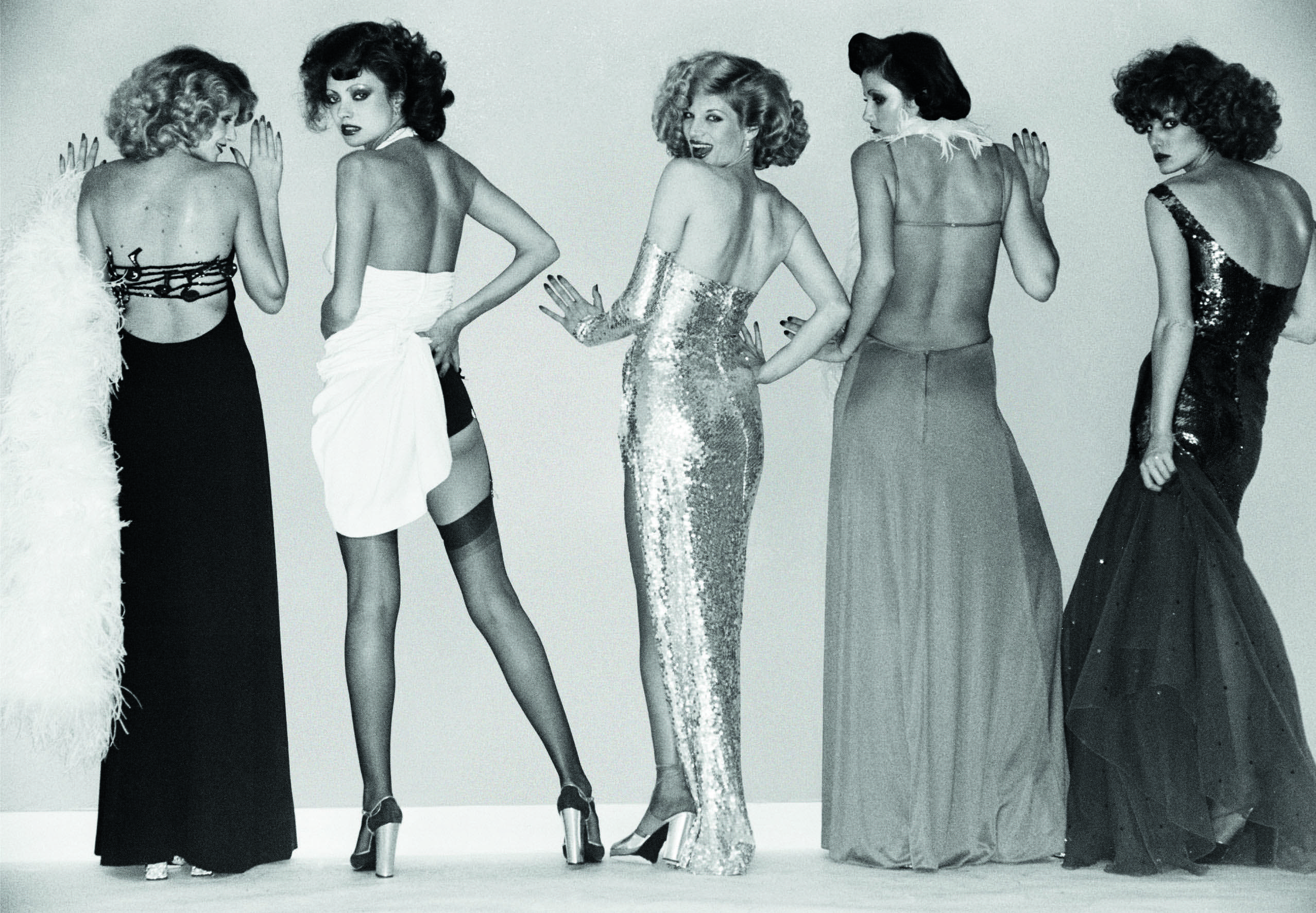 An archive photograph of models in looks by Azzaro.