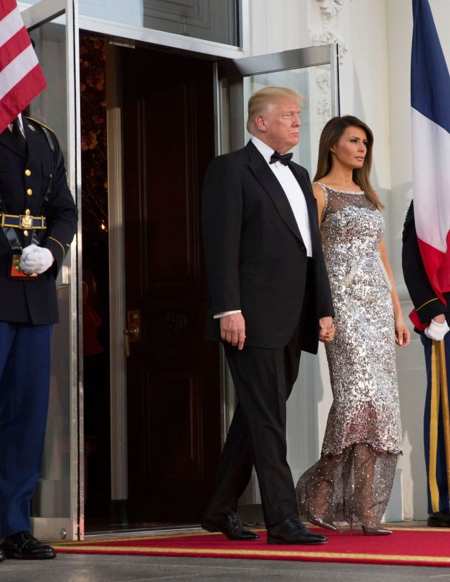 Donald J. Trump and Melania TrumpFrench President Macron state visit to the USA, Washington - 24 Apr 2018 United States President Donald J. Trump (L) and First Lady Melania Trump (R) wait to welcome French President Emmanuel Macron and his wife Brigitte Macron at the North Portico of the White House before a state dinner in Washington, DC, USA, 24 April 2018. President Macron is in DC for three days for a state visit and an address to a joint session of Congress on 25 April.