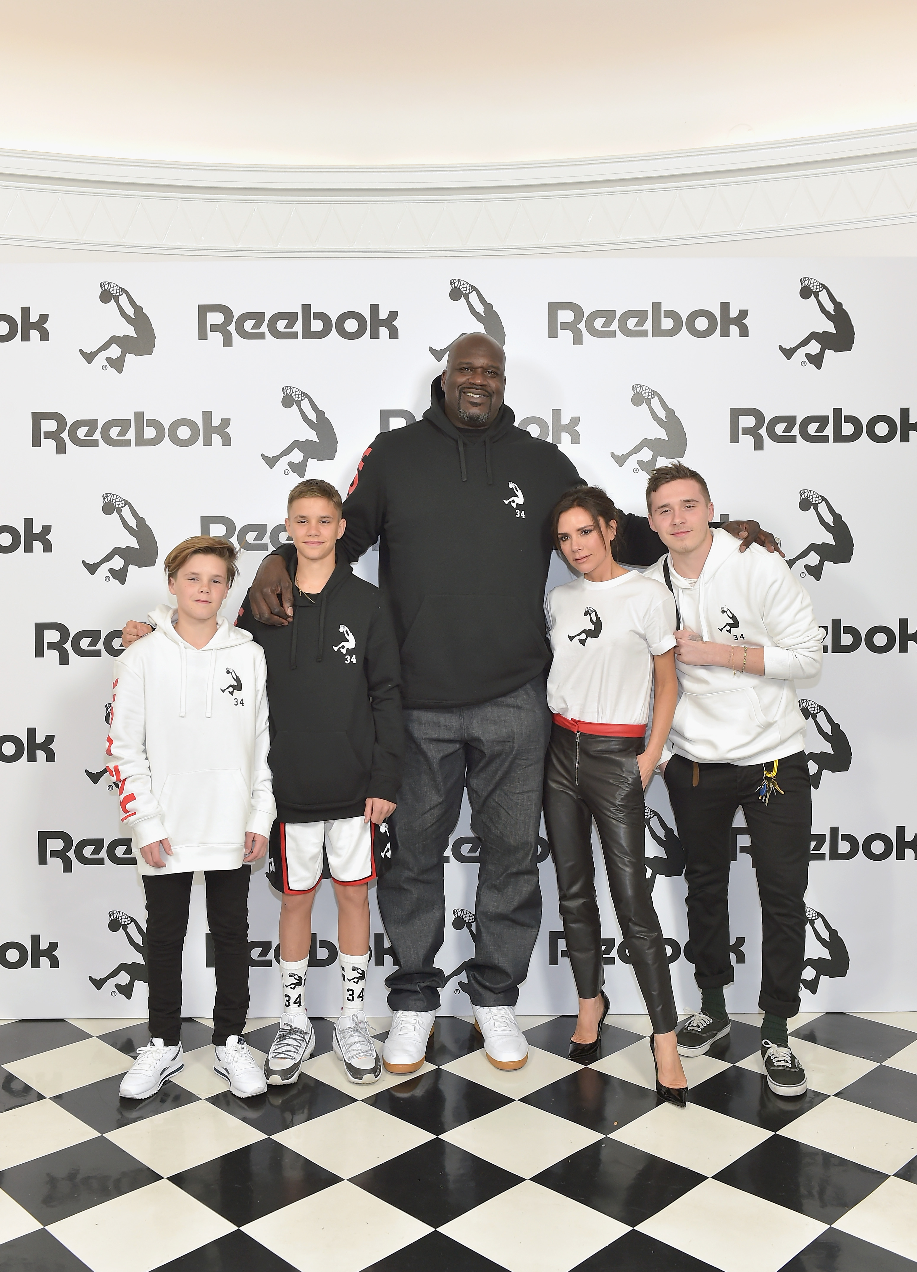 Cruz Beckham, Romeo Beckham, Shaquille O'Neal, Victoria Beckham and Brooklyn Beckham attend an event celebrating Reebok and Victoria Beckham celebrate their partnership. Special guest Shaquille O'Neal officially welcomes Victoria to the Reebok Team at The House on Sunset on April 12, 2018 in Beverly Hills, California. (Photo by Donato Sardella/Getty Images for Reebok) *** Local Caption *** Cruz Beckham, Romeo Beckham, Shaquille O'Neal, Victoria Beckham;Brooklyn Beckham